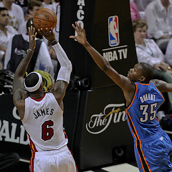 Jun 19, 2012; Miami, FL, USA; Miami Heat small forward LeBron James (6)shoots over Oklahoma City Thunder small forward Kevin Durant (35) during the fourth quarter in game four in the 2012 NBA Finals at the American Airlines Arena. Mandatory Credit: Derick E. Hingle-US PRESSWIRE