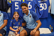 Mascot and AFC Wimbledon defender Will Nightingale (5) during the EFL Sky Bet League 1 match between AFC Wimbledon and Rotherham United at the Cherry Red Records Stadium, Kingston, England on 3 August 2019.
