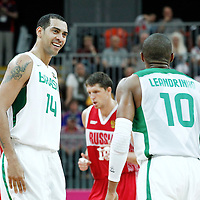 02 August 2012: Brazil Marquinhos Vieira Sousa celebrates with Leandrinho Barbosa during 75-74 Team Russia victory over Team Brazil, during the men's basketball preliminary, at the Basketball Arena, in London, Great Britain.