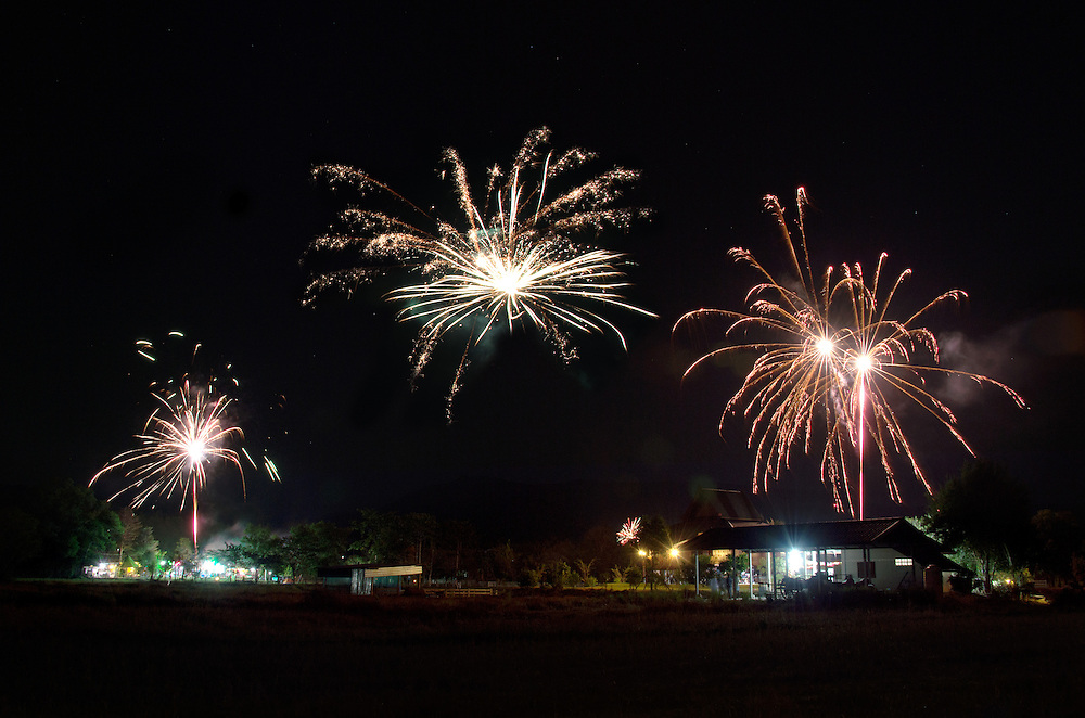 Fireworks as seen for a farm on New Years Eve, in Nakhon Nayok, Thailand
