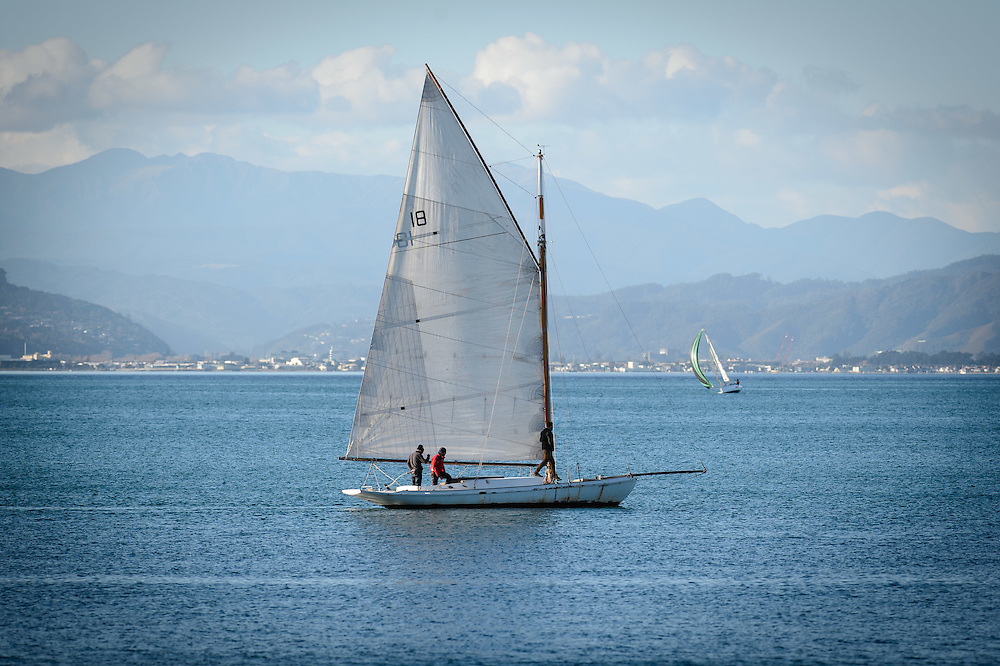 A old yacht sails in Wellington Harbour with the<br /> The Tararua Range visible behind. WELLINGTON, NEW ZEALAND - July 16: Wellington Harbour July 16, 2016 in Wellington, New Zealand. (Photo by Mark Tantrum/ http://marktantrum.com)