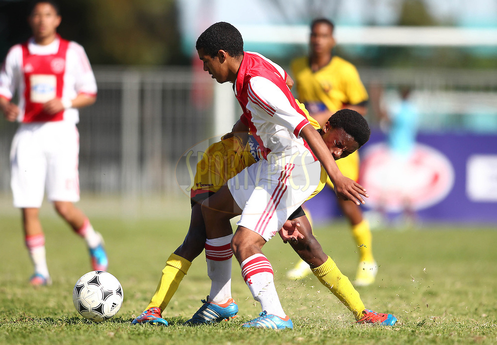 Mbelelo Mathiso of Engen Santos and Shane Saralina of Ajax Cape Town battle for possession during the Final on the final day of the Engen Knock Out Challenge held at Stephen Reagan Sports Ground, Mitchells Plain in Cape Town on the 30th September 2012..Photo by Shaun Roy/ SPORTZPICS..