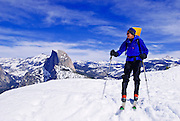 Backcountry skier and Half Dome from Glacier Point, Yosemite National Park, California USA