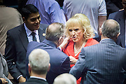 09 JANUARY 2012 - PHOENIX, AZ:   Arizona Governor Jan Brewer talks to legislators after her speech as she leaves the House chambers  at the state legislature Monday. Gov Brewer delivered her State of the State inside while outside representatives of interest groups picketed and protested. The Arizona legislature started its 2012 session and Gov. Jan Brewer delivered her State of the State Monday, Jan 9.                   PHOTO BY JACK KURTZ
