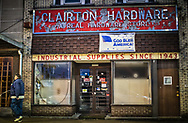 Man walking by a hardware store in Clairton, Pennsylvania.