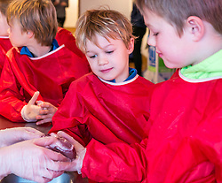 City Arts Centre, Edinburgh, Scotland, United Kingdom, 9 April 2019. Edinburgh Science Festival:  Children have fun learning about blood with a sheep heart at the Blood Bar drop in event at the Science Festival. <br /> <br /> Sally Anderson | EdinburghElitemedia.co.uk