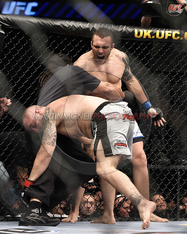 "LONDON, ENGLAND, JUNE 7, 2008: Luiz Cane (facing) has an adrenaline dump whilst being restrained by referee Herb Dean after knocking out Jason Lambert during ""UFC 85: Bedlam"" inside the O2 Arena in Greenwich, London on June 7, 2008."