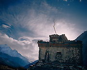 Chorten and storm clouds. Kagbeni Village. Annapurna trek, Nepal