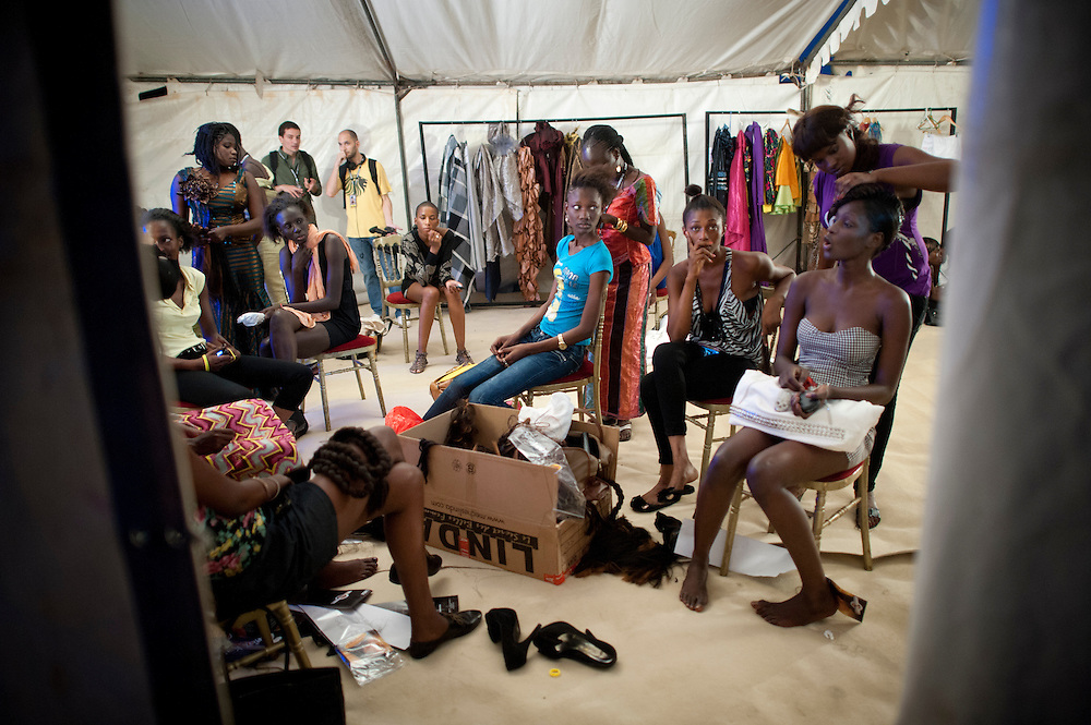15/06/2012. Senegal, Dakar.  Backstage scene on June 15, 2012 at the third day of the Dakar Fashion Week's 10 year anniversary taking place from June 12 to 17. ©Sylvain Cherkaoui