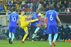 November 14, 2017 - Bucharest, Romania - Cosmin Moti (ROM) vies Ryan (NED) during International Friendly match between Romania and Netherlands at National Arena Stadium in Bucharest, Romania, on 14 november 2017. (Credit Image: © Alex Nicodim/NurPhoto via ZUMA Press)