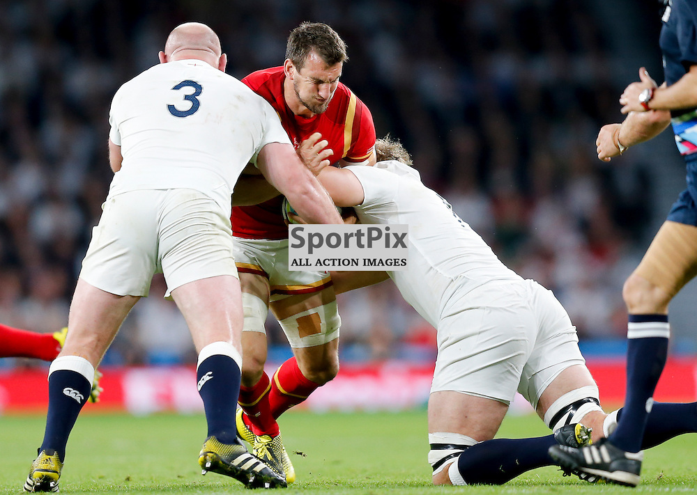 TWICKENHAM, ENGLAND - SEPTEMBER 26:  Sam Warburton (Captain) of Wales tackled by England's tight head prop Dan Cole (3) during the 2015 Rugby World Cup Pool A match between England and Wales at Twickenham Stadium on September 26, 2015 in London, England. (Credit: SAM TODD | SportPix.org.uk)