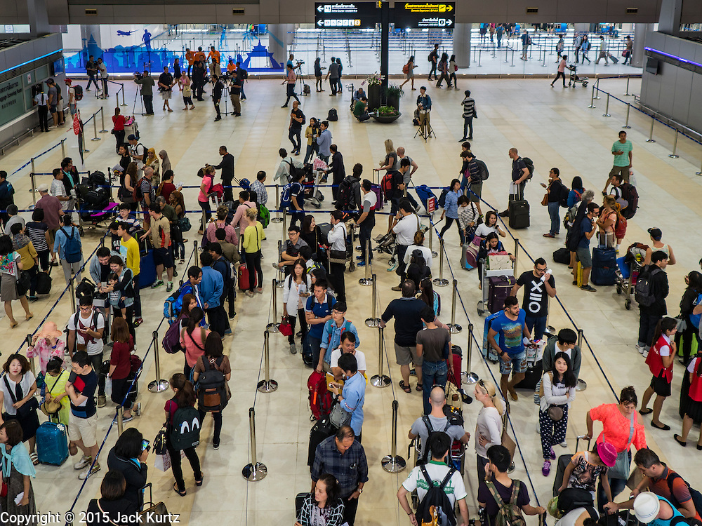 """24 DECEMBER 2015 - BANGKOK, THAILAND:  Passengers in the new domestic terminal at Don Muang (also spelled Don Mueang) International Airport. The new terminal had its """"soft"""" opening Dec. 24. Don Muang is the airport used by low cost airlines serving Bangkok and is now the largest airport in the world for low cost carriers. In 2014, more than 21million passengers used Don Muang. Don Muang International Airport is the oldest airport in Asia and one of the oldest airports in the world. It started functioning as an airfield in 1914.    PHOTO BY JACK KURTZ"""