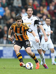 Hull's Shane Long holds off Swansea's Miguel Michu - Photo mandatory by-line: Matt Bunn/JMP - Tel: Mobile: 07966 386802 05/04/2014 - SPORT - FOOTBALL - KC Stadium - Hull - Hull City v Swansea City- Barclays Premiership