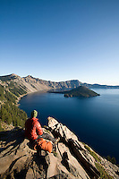 Young man hiking around Crater Lake National Park, OR.