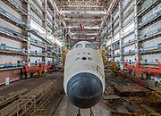 Urban Explorer Finds The Sad Remains Of The Soviet Space Shuttle Program<br /> <br /> Ralph Mirebs, an urban explorer and photographer in Russia, has revealed extraordinary photos of Soviet space shuttle prototypes gathering dust in an abandoned hangar in Kazakhstan.<br /> <br /> The abandoned hangar is located at the Baikonur Cosmodrome in Kazakhstan, which is still in operation today (with the close of NASA's shuttle program, Russian Soyuz shuttles are the only way for astronauts to reach the International Space Station). The Buran prototype shuttles found by Mirebs, however, are from an earlier era – they are the last remnants of a space program that began in 1974 and was finally shuttered in 1993. The only operational Buran shuttle, Orbiter 1K1, completed one unmanned orbital flight before it was grounded. Unfortunately, this shuttle was destroyed in a hangar collapse in 2002.<br /> <br /> many areas of the huge Baikonur Cosmodrome are still in business today, and that it is from here that the Soyuz rockets are launched, supplying the International Space Station in supplies and crew members<br /> Mirebs' photos show this forgotten space program derelict and frozen in time.<br /> ©Ralph Mirebs/Exclusivepix Media