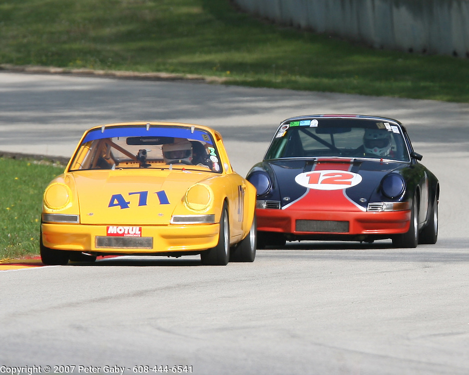 Wayne Baker #471 leads #12 Jeff Jagusch out of Thunder Valley during the Qualifying 3 session on Sat. May 19th at Road America for the Vintage GT Challenge presented by UBS*Mike Scott
