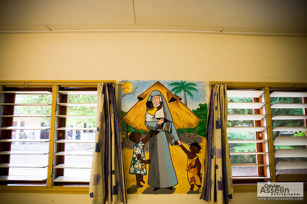 Wall painting portraying a white nun and black children at the NDA health center in Dimbokro, Cote d'Ivoire on Friday June 19, 2009.
