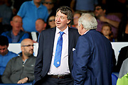 Posh joint owner Dr Jason Neale talking to Barry Fry before the EFL Sky Bet League 1 match between Peterborough United and Luton Town at London Road, Peterborough, England on 18 August 2018.
