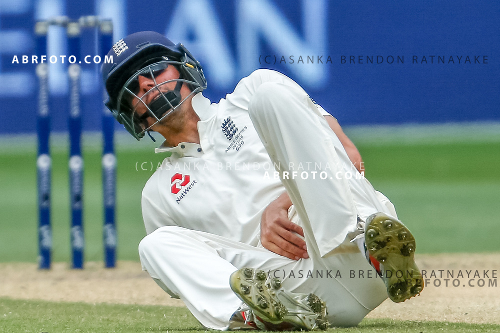 Alastair Cook on the ground feels his groin region after being hit during day 5 of the 2017 boxing day test.