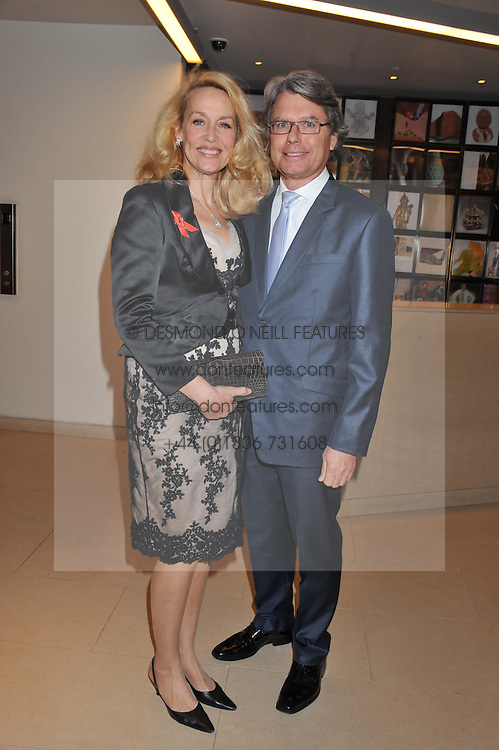 JERRY HALL and WARWICK HEMSLEY at the Lighthouse Gala Auction in aid of The Terrence Higgins Trust held at Christie's, 8 King Street, St.James' London on 19th March 2012.