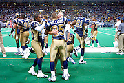 St. Louis Rams players and coaches celebrate after a 15 to 14 win over the New York Giants on 10/14/2001..©Wesley Hitt/NFL Photos