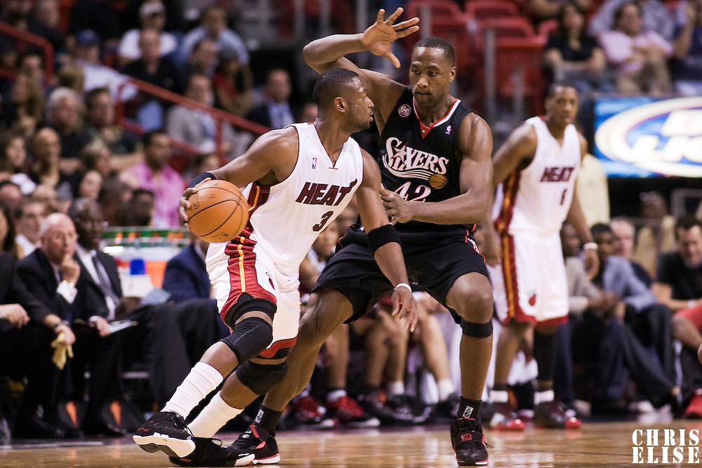 5 November 2008: Dwyane Wade of the Miami Heat dribbles against Elton Brand of the Philadelphia 76ers during the Miami Heat 106-83 victory over the Philadelphia 76ers at AmericanAirlines Arena, in Miami, Florida, USA.