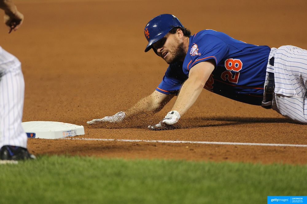 Daniel Murphy, New York Mets, slides into third base on a triple during the New York Mets Vs New York Yankees MLB regular season baseball game at Citi Field, Queens, New York. USA. 18th September 2015. Photo Tim Clayton
