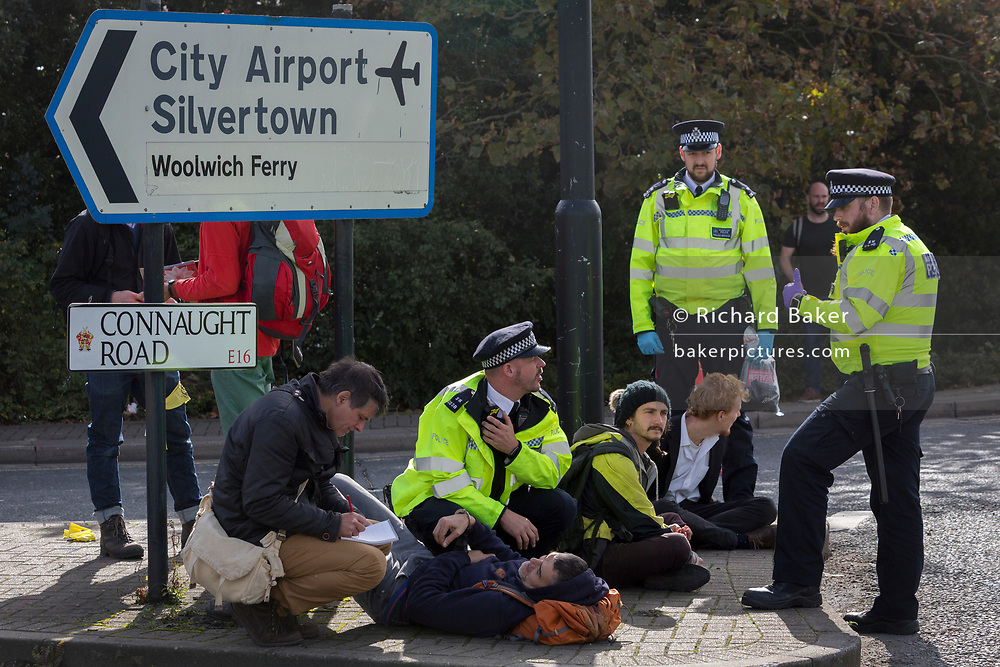 An environmental activist is arrested while protesting about Climate Change during the occupation of City Airport (London's Business Travel hub) in east London, the fourth day of a two-week prolonged worldwide protest by members of Extinction Rebellion, on 10th October 2019, in London, England.