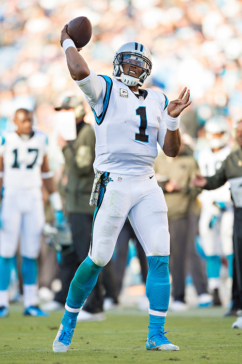 NASHVILLE, TN - NOVEMBER 15:  Cam Newton #1 of the Carolina Panthers throws a pass while staying warm during a timeout against the Tennessee Titans at Nissan Stadium on November 15, 2015 in Nashville, Tennessee.  (Photo by Wesley Hitt/Getty Images) *** Local Caption *** Cam Newton