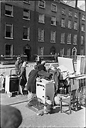 "15/06/1963.06/15/1963.15 June 1963.Dublin tenements evacuated at Fenian Street..The scen this morning at Fenian Street, Dublin as families living in century  old tenement houses evacuate their homes at No.9 and 10, and await the expected collapse of the buildings..""The houses are only a few doors away from those which collapsed on Wednesday last, killing two schoolgirls. Most of the families spent the night on the roadside with their furniture..Dublin Tenements, collapsing in various parts of the city recently has caused a stste of emergency. Corporation officals are franticly trying to find alternative accomodation for hundreds of families occuping condemned or dangerous houses."""