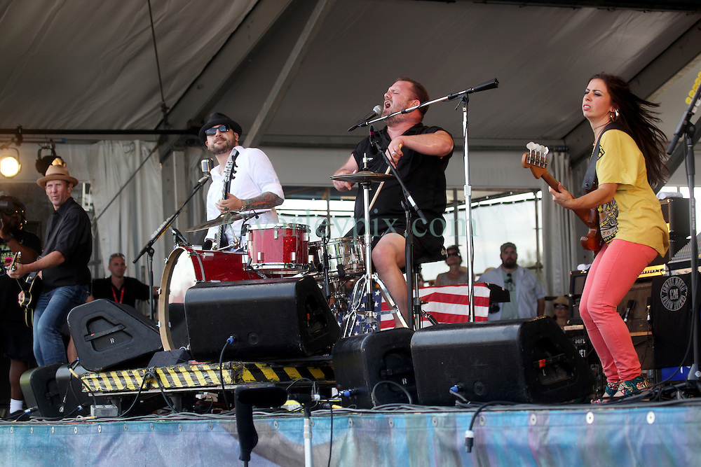29 April 2012. New Orleans, Louisiana,  USA. <br /> New Orleans Jazz and Heritage Festival. <br /> L/R; John Thomas Griffith, Matt Jones, Fred LeBlanc and Casandra Faulconer of Cowboy Mouth.<br /> Photo; Charlie Varley