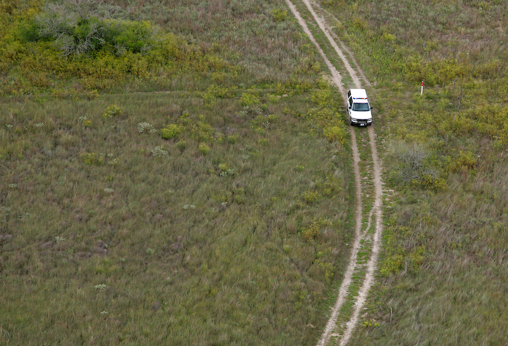 Photo by Alex Jones..A Border Patrol unit makes its way through a ranch in Brooks County being patrolled by the Minutemen on October 27.