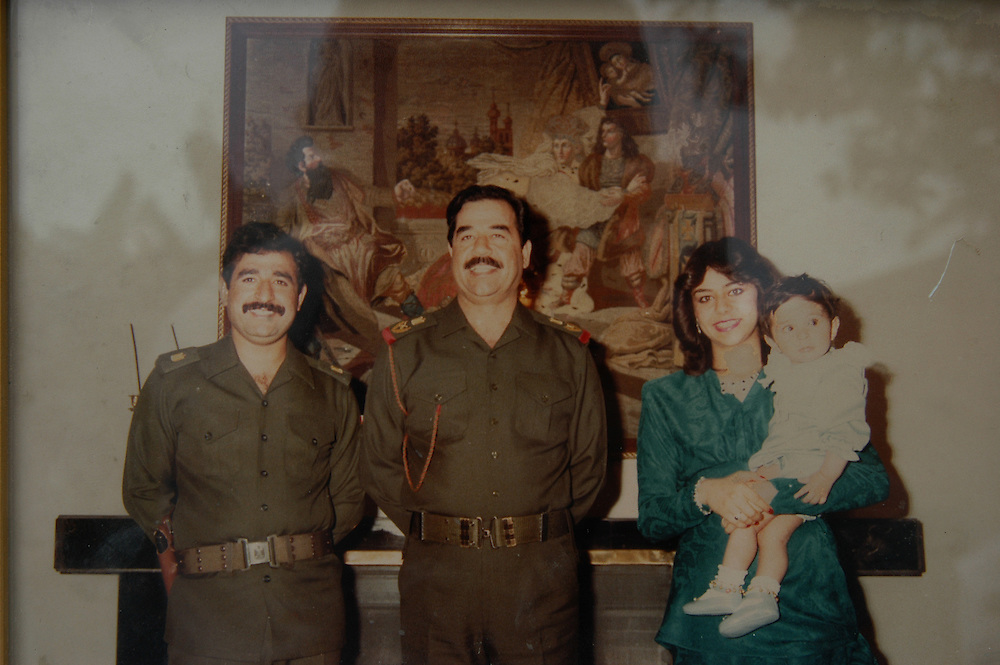 In a family picture, Saddam Hussein poses with his daughter Rana, his grandson Ali and his son-in-law Saddam Kamel. Saddam Kamel, his brother Hussein, also a son-in-law, and 15 members of their family were killd by Saddam Hussein when they returned to Iraq after fleeing to Jordon..Baghdad, Iraq. 30 May 2003..Photo © J.B. Russell