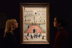 "© Licensed to London News Pictures. 17/11/2017. London, UK.  London, UK.  17 November 2017. Staff members view ""The Steps"", 1962, by L.S. Lowry (Est. GBP 0.65-0.8m).  Preview upcoming auctions of Modern & Post War British Art and Scottish Art taking place at Sotheby's, New Bond Street, on 21 and 22 November. Photo credit: Stephen Chung/LNP"