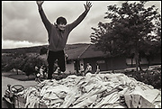 JUMPING ON A PILE OF LAUNDY, Butlins Holiday Camp, Minehead, Somerset. Summer 1979.