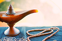 Still Life Photography mala and genie lamp.