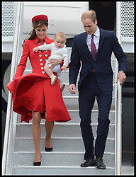 The Duke and Duchess of Cambridge with their son Prince George arrive at the Military Terminal at Wellington Airport on a Royal New Zealand Air Force aircraft,  Monday, 7th April 2014, at the start of their Royal Tour of New Zealand and Australia. Picture by Andrew Parsons / i-Images