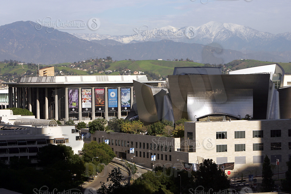 Jan 16, 2005; Los Angeles, CA, USA; Downtown Los Angeles city scape. View of Los Angeles Performing Arts Center and the Walt Disney Concert Hall on 1st and Hope Streets, designed by Frank Gehry with snow on the mountains behind in the background. Scenic view of downtown LA skyline from inside the city.  Mandatory Credit: Photo by Shelly Castellano/ZUMA Press.