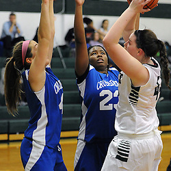 TOM KELLY IV &mdash; DAILY TIMES<br /> Christian Academy's Danay Cooks (23) and Carli Sitkowski (4) defend DCS's Shirley Piotrowski (44) under the hoop during the, The Christian Academy at Delaware County Christian School girls basketball game on Friday afternoon, December 12, 2014.