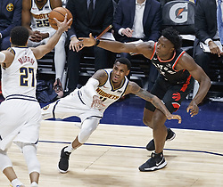 December 16, 2018 - Denver, Colorado, U.S - Nuggets MONTE MORRIS, center, battles for the loose ball during the 2nd. Half at the Pepsi Center Sunday evening. The Nuggets beat the Raptors 95-86. (Credit Image: © Hector Acevedo/ZUMA Wire)