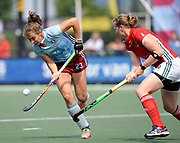 Hamburg's Marie Maver takes the ball past Canterbury's Mel Clewlow during their opening game of the EHCC 2017 at Den Bosch HC, The Netherlands, 2nd June 2017