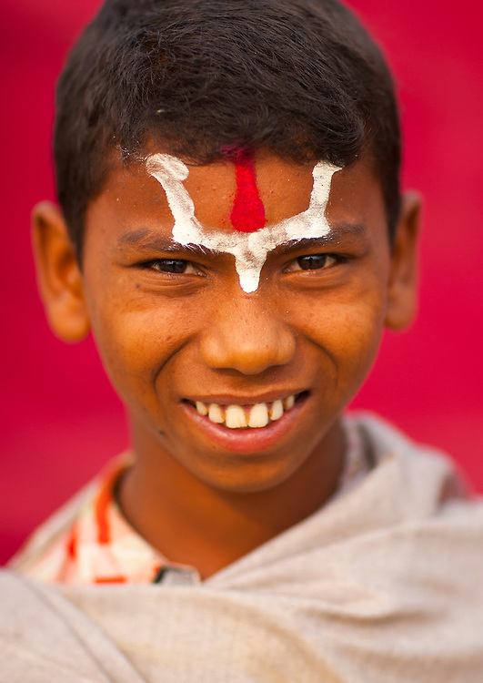 Kid during Maha Kumbh Mela, a festival known as world's largest congregation of religious pilgrims. Allahabad, India.