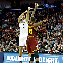 Jan 23, 2017; New Orleans, LA, USA; New Orleans Pelicans forward Donatas Motiejunas (12) shoots over Cleveland Cavaliers center Tristan Thompson (13) during the second half of a game at the Smoothie King Center. The Pelicans defeated the Cavaliers 124-122. Mandatory Credit: Derick E. Hingle-USA TODAY Sports
