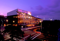 Stock photo of a night view of the Hobby Center in downtown Houston Texas