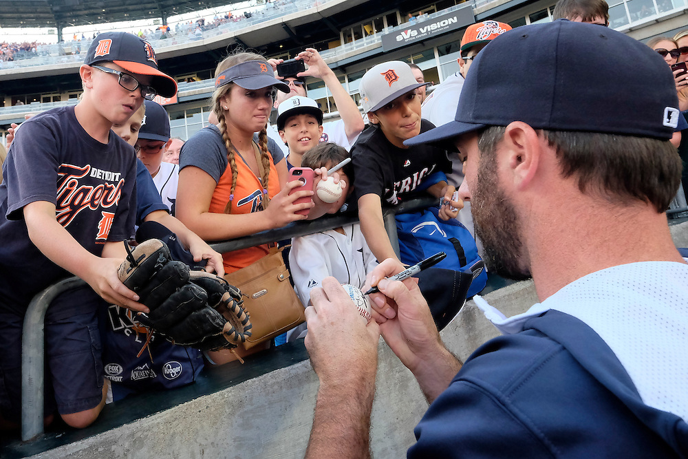 Aug 7, 2015; Detroit, MI, USA; Detroit Tigers starting pitcher Justin Verlander (35) signs autographs before the game against the Boston Red Sox at Comerica Park. Mandatory Credit: Rick Osentoski-USA TODAY Sports