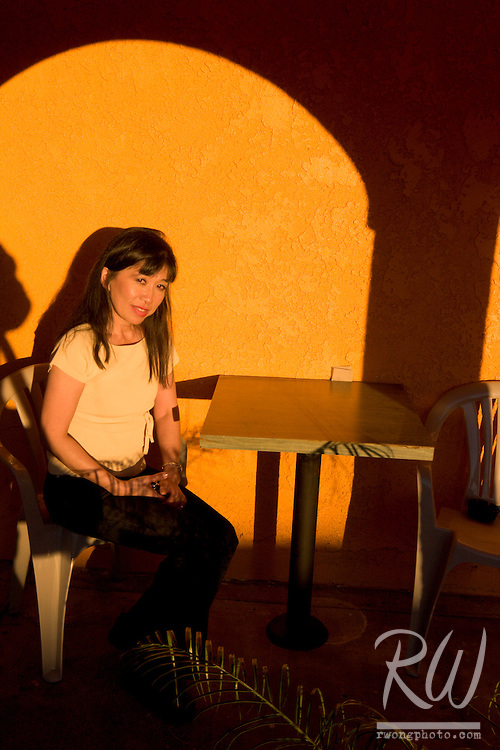 Woman Sitting on Chair at a Mexican Restaurant, Mentone, California