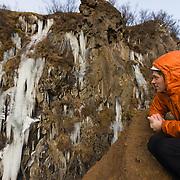 """Viðar Helgasson climbing """"Álið er málið"""" WI4, Freyr Ingi Björnsson on the sideline. Þórólfsárgili, Fljótshlíð, Iceland."""