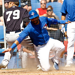 March 8, 2011; Dunedin, FL, USA; Toronto Blue Jays right fielder Jose Bautista (19) scores on a passed ball during the bottom of the third inning of a spring training game against the New York Yankees at Florida Auto Exchange Stadium. Mandatory Credit: Derick E. Hingle-US PRESSWIRE