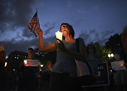 August 13, 2017 - Washington, DC, U.S - SUSAN SHATTUCK of DC participates in ''Charlottesville Solidarity Action'' that held a candlelight vigil in front of the White House in Washington.  Protests took place in many states following the violence and tragedy in Charlottesville VA on Saturday during a White Supremacist ''Unite the Right'' rally resulting in deaths and injuries. (Credit Image: © Carol Guzy via ZUMA Wire)