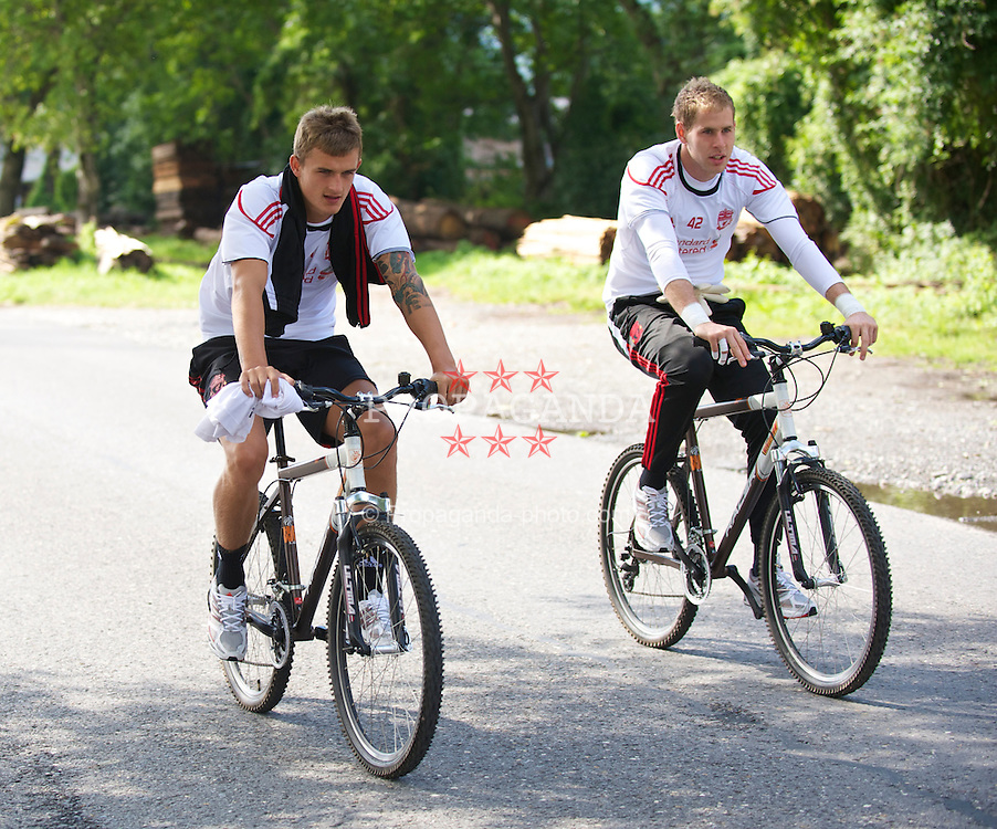 BAD RAGAZ, SWITZERLAND - Sunday, July 18th, 2010: Liverpool goalkeepers Martin Hansen and Peter Gulacsi arrive on a bicycle for a training session during the Reds' preseason training camp in Switzerland. (Pic by David Rawcliffe/Propaganda)